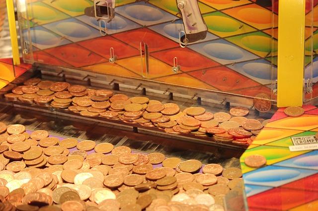 ゲームセンターでメダルゲーム(コインゲーム)をしている夢占い